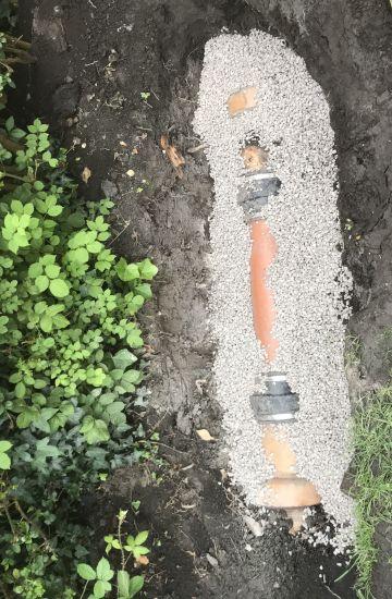 Drain repair and new aco drain installation.